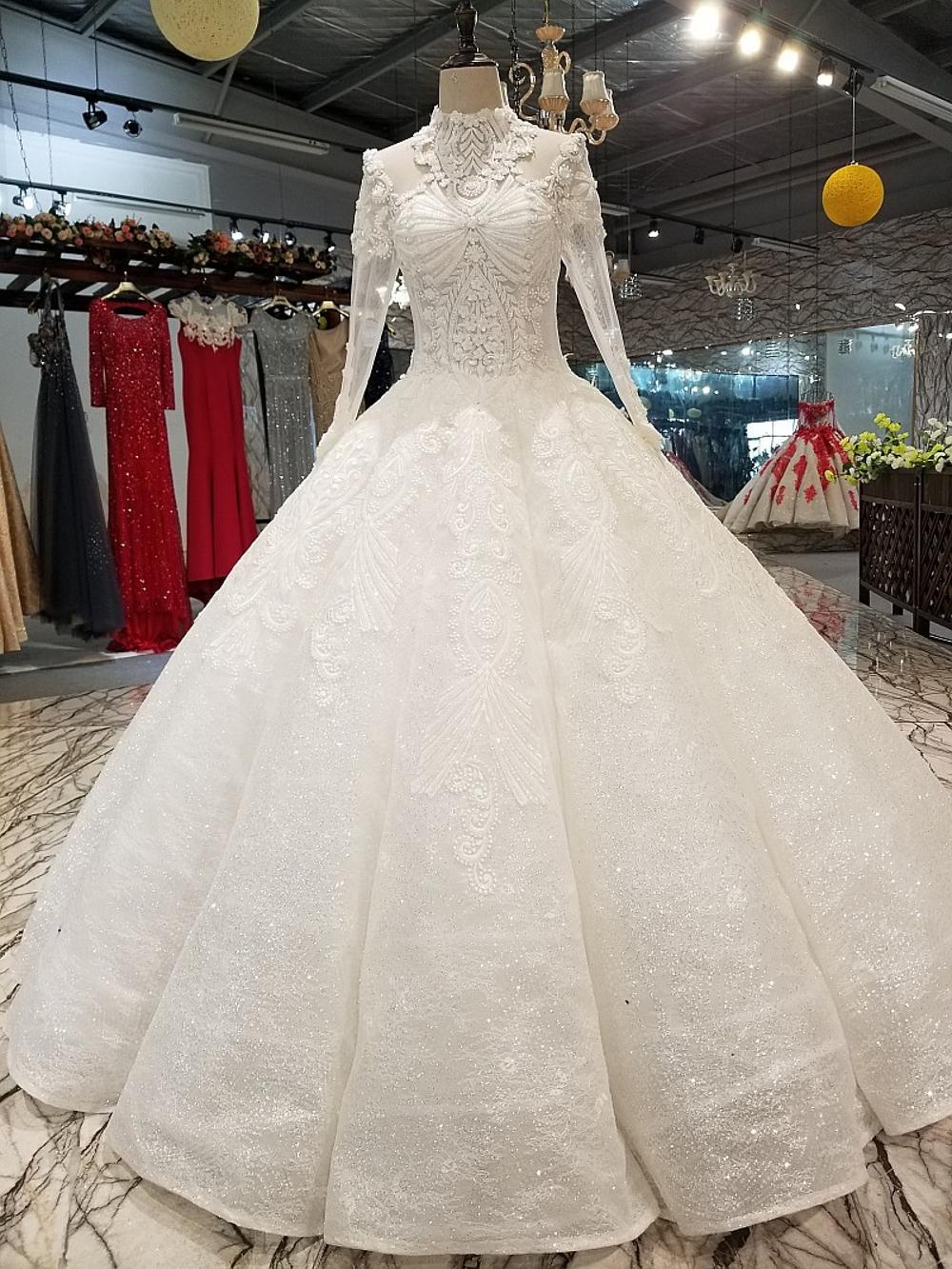بالصور فساتين زفاف محجبات , ارقي فساتين ليلة العمر للعرائس المحجبات 2075 7